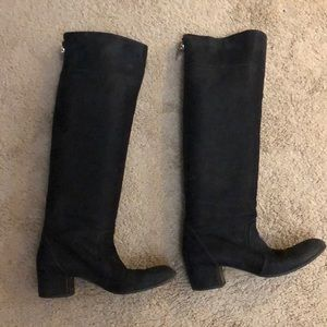 Black knee high Chanel boots